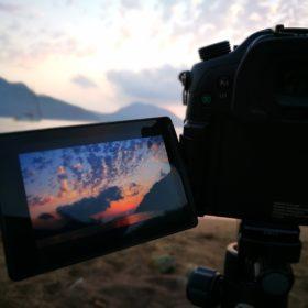 Video camera recording dusk on the beach